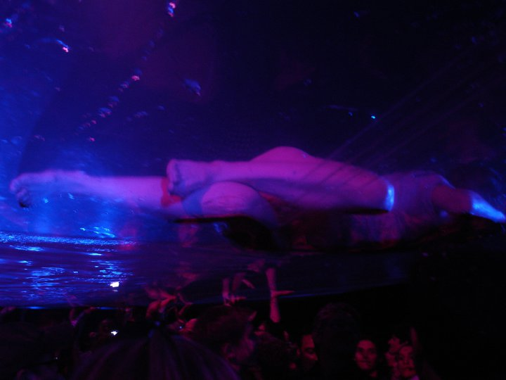 Woman frolicking in a watery world just inches above the audience